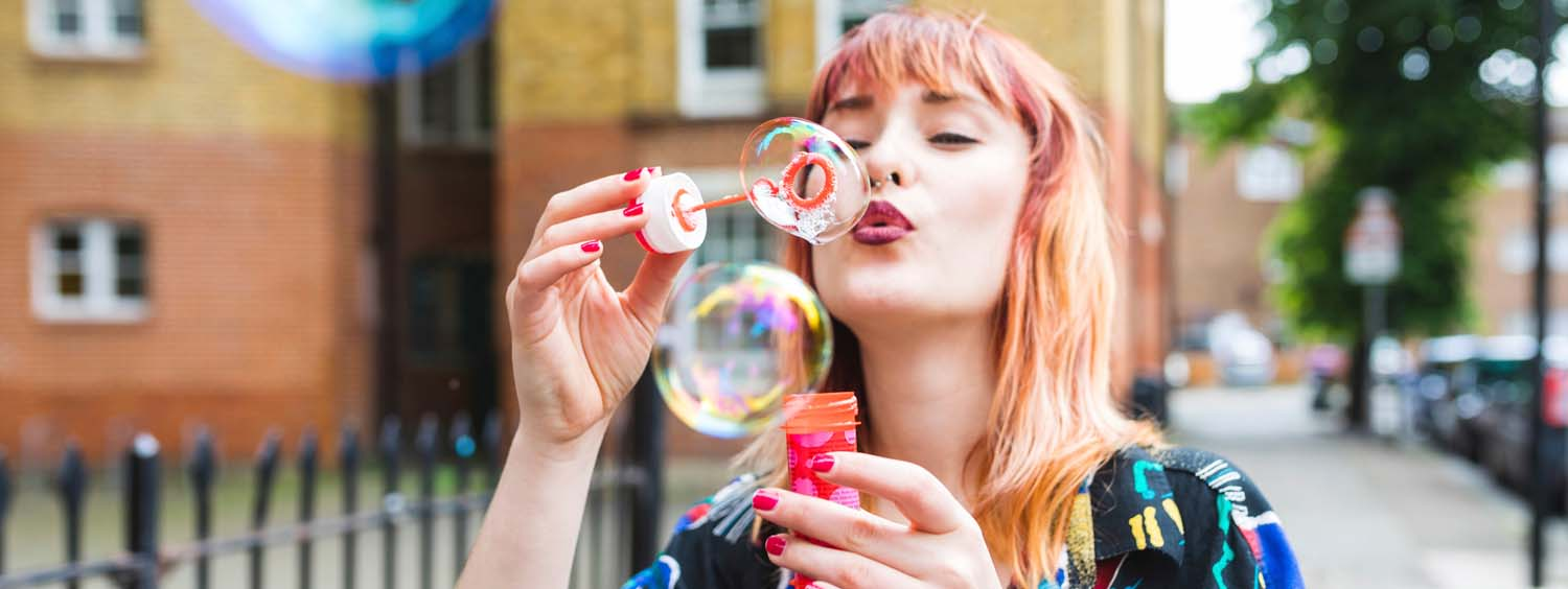 1500x564_woman-with-unicorn-hair-blowing-bubbles